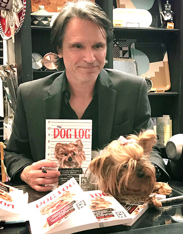 Richard Lucas, author of The Dog Log, signing books after reading at West Hollywood's Book Soup